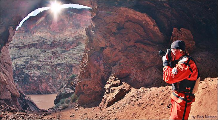 kayaker taking photos in grand canyon